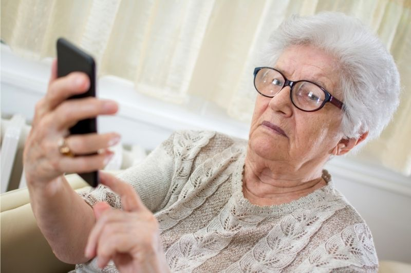 old lady confused by phone